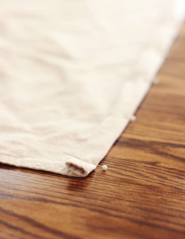 Pin the hem of your drop cloth as you proceed on your project.