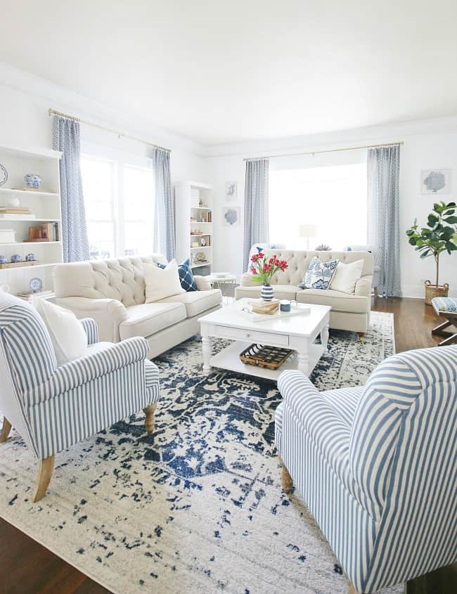 easiest way to line curtains blue and white living room with flowers