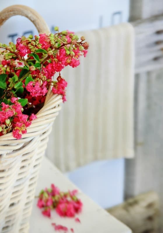 This basket of flowers is rustic and ideal for that farmhouse feel.