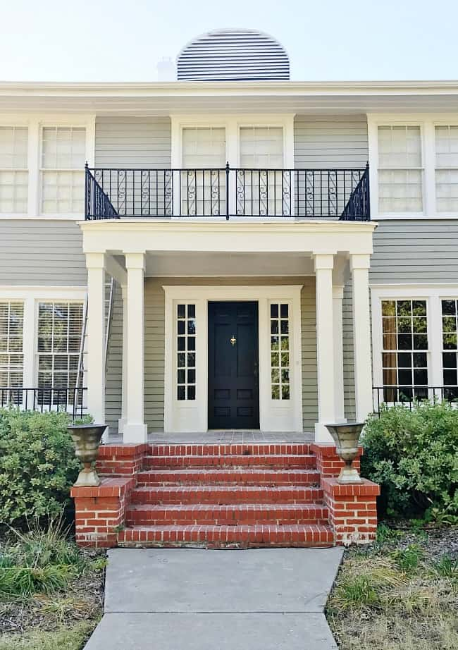This shade of grey does a perfect job enhancing the door color and window trim.