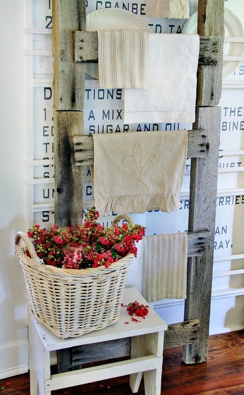 The dark stained barn wood ladder pairs well with the white walls.