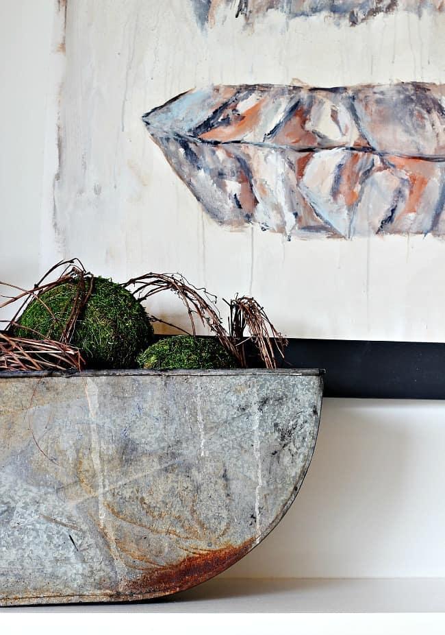 metal tin with grass spheres