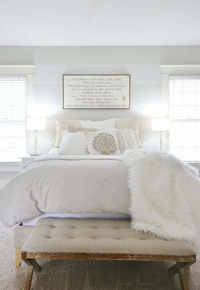 This farmhouse style bedroom is brighter and full of light from the paint upgrade