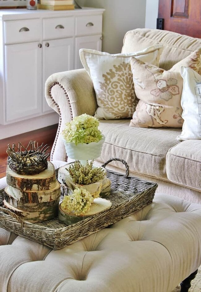 These wood slices in the woven basket are great farmhouse decor.