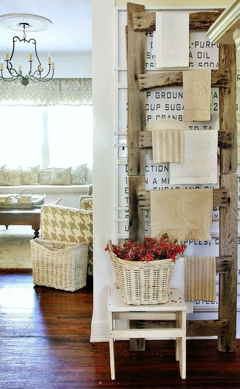This barn wood ladder is adorable for hanging dish towels in the kitchen area.