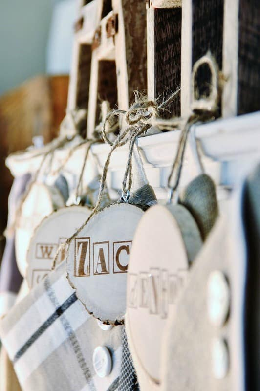 Add an eye hook and twine to hang the tags from your stocking