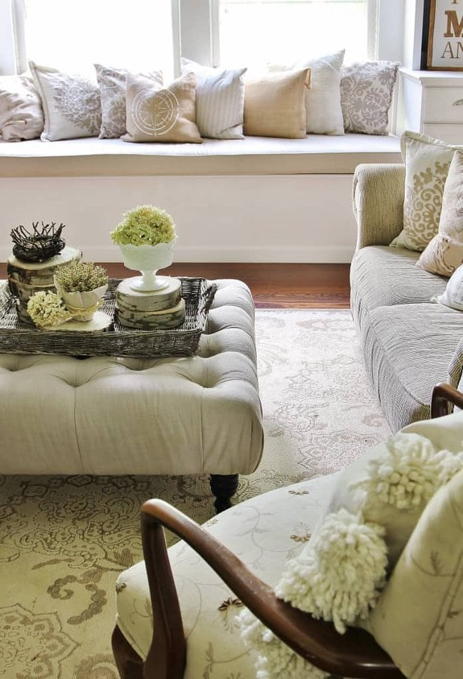 The wood slice center pieces stand out in the elegantly neutral living room.
