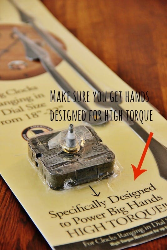 Drill holes into your yardsticks and attach clock hand parts from your kit.