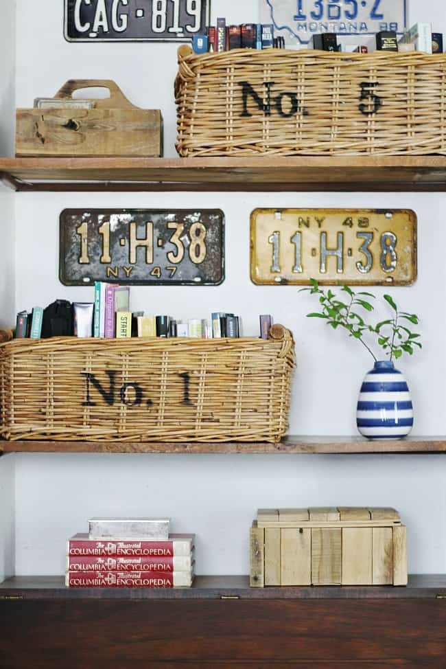 Baskets and license plates make up great accents in the room for bedroom inspiration