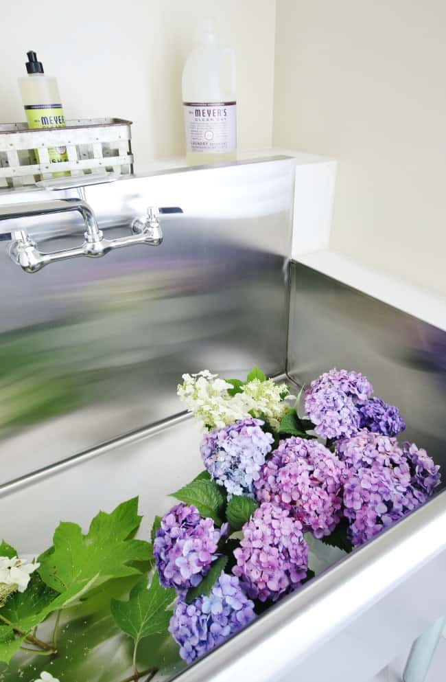 how to decorate with hydrangeas display in laundry room