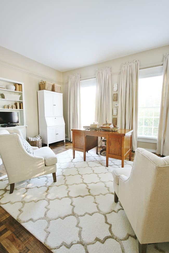 drop cloth curtains in office with cream rug and desk
