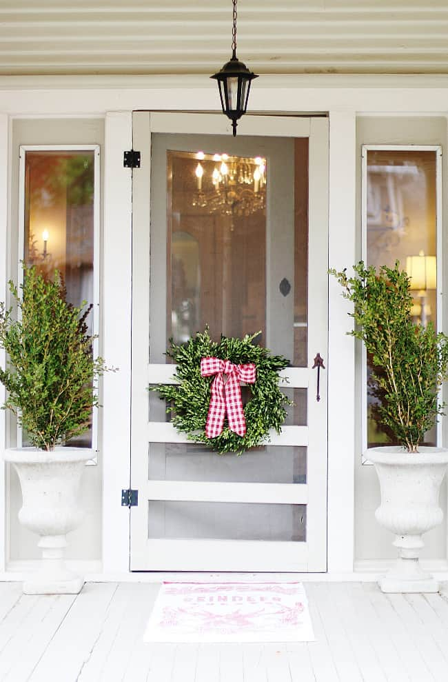 decorating a Christmas cottage door