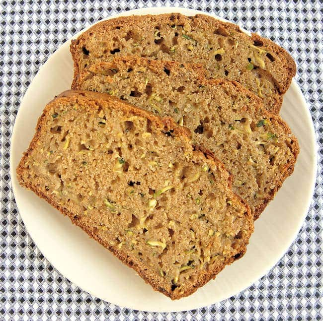 three slices of whole wheat zucchini bread on a plate