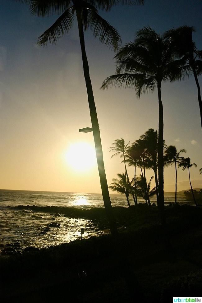 Beautiful Hawaiian sunset on Poipu Beach in Kauai, Hawaii on UrbanBlissLife.com