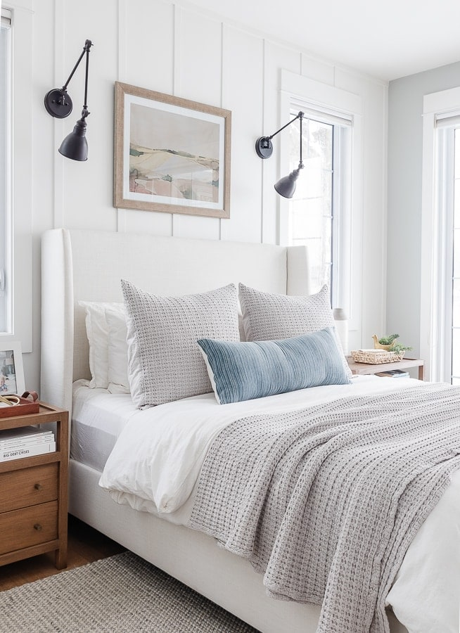 white duvet cover, gray waffle knit throw blanket and pillow. Lake house bedroom.
