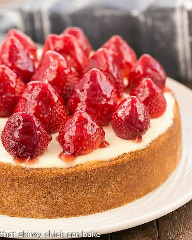 Strawberry Topped Cheesecake on white serving plate