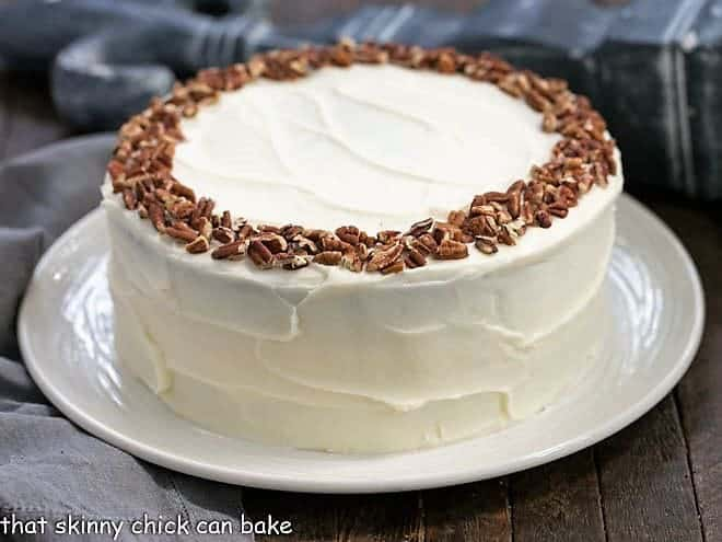Cheesecake Filled Carrot Cake on a white serving plate