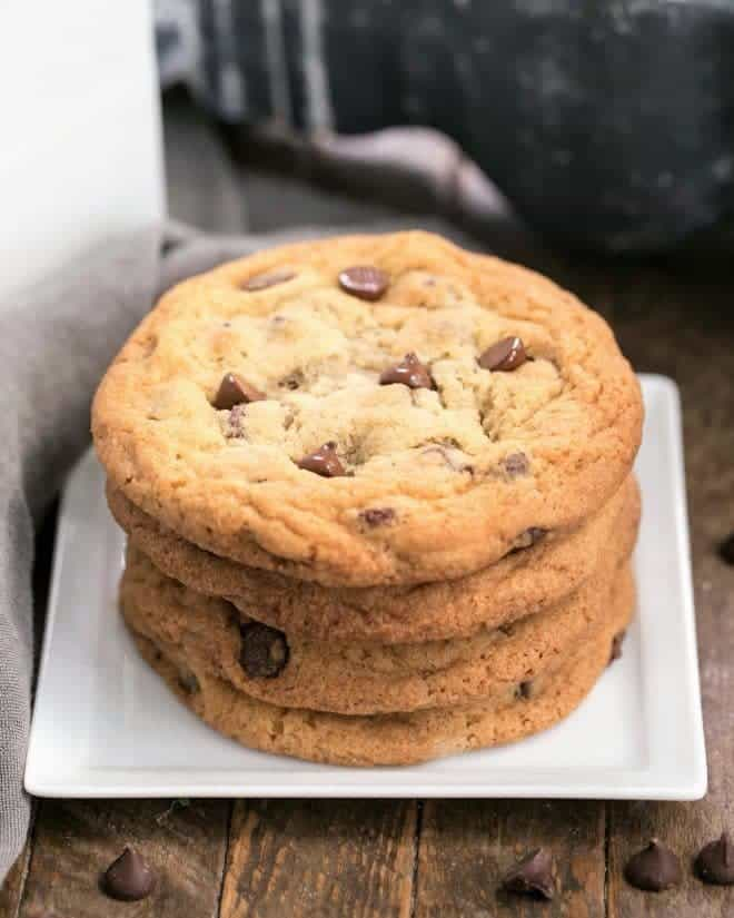 A stack of Thin Chewy Chocolate Chip Cookies on a square plate