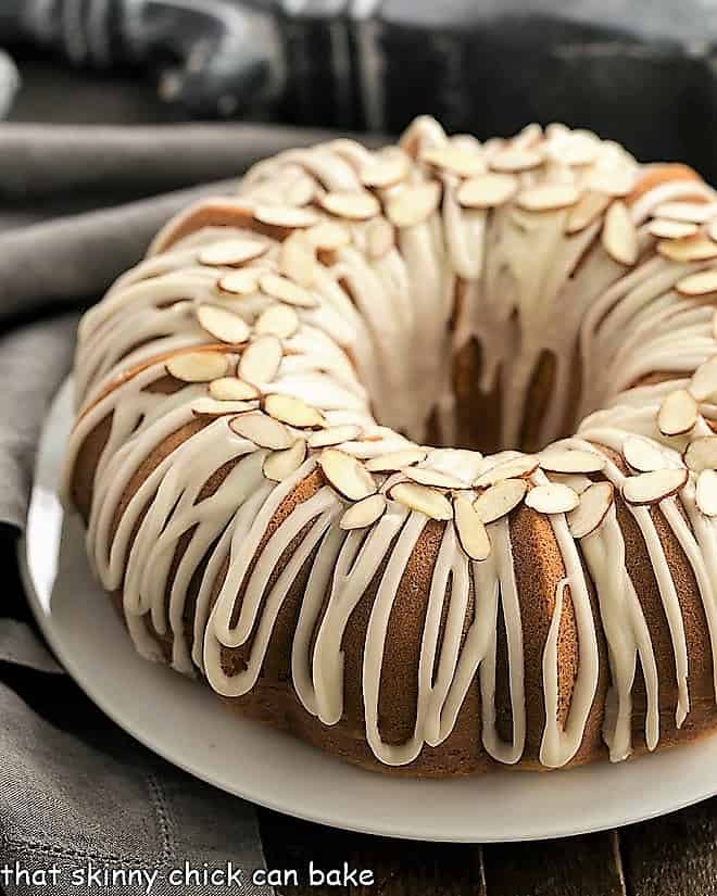 Easy Almond Bundt Cake with Amaretto Glaze on a white serving plate