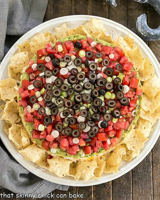 Overhead view of Layered Taco Dip surrounded by tortilla chips