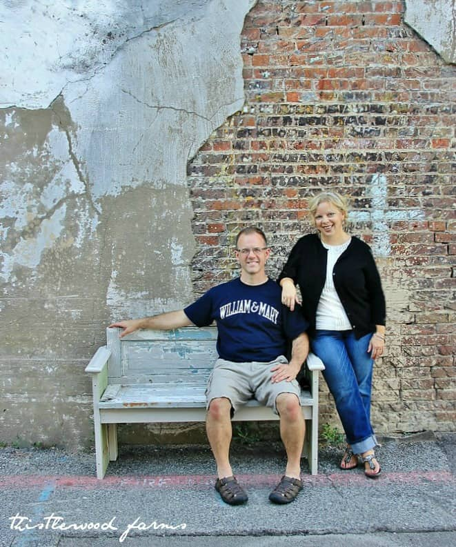 KariAnne and her brother pose with the new bench made from an old door