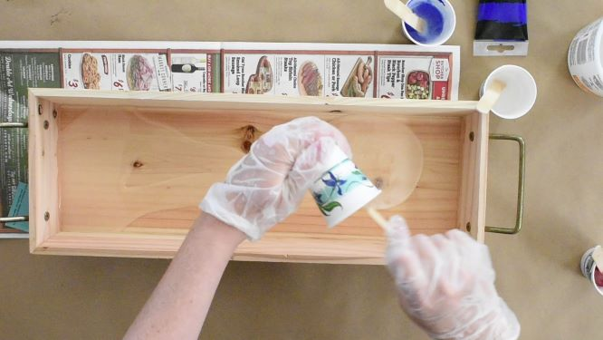 pouring clear resin in bottom of decorative tray