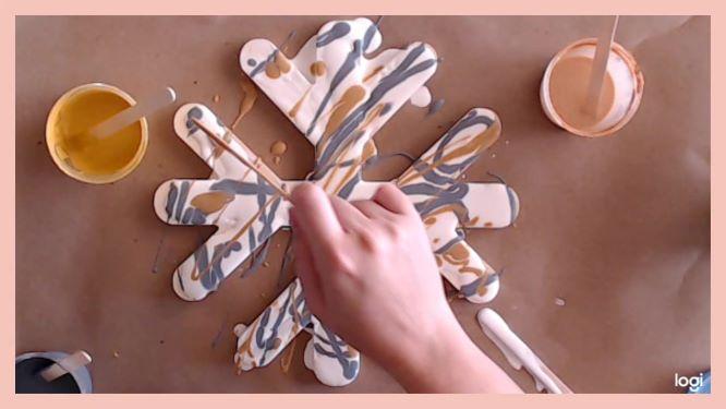 dip painting on wooden snowflake