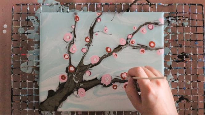 adding cherry blossoms to cherry blossom tree painting