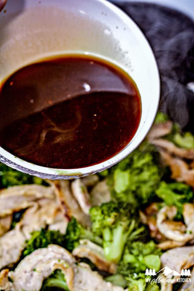 adding sauce to skillet