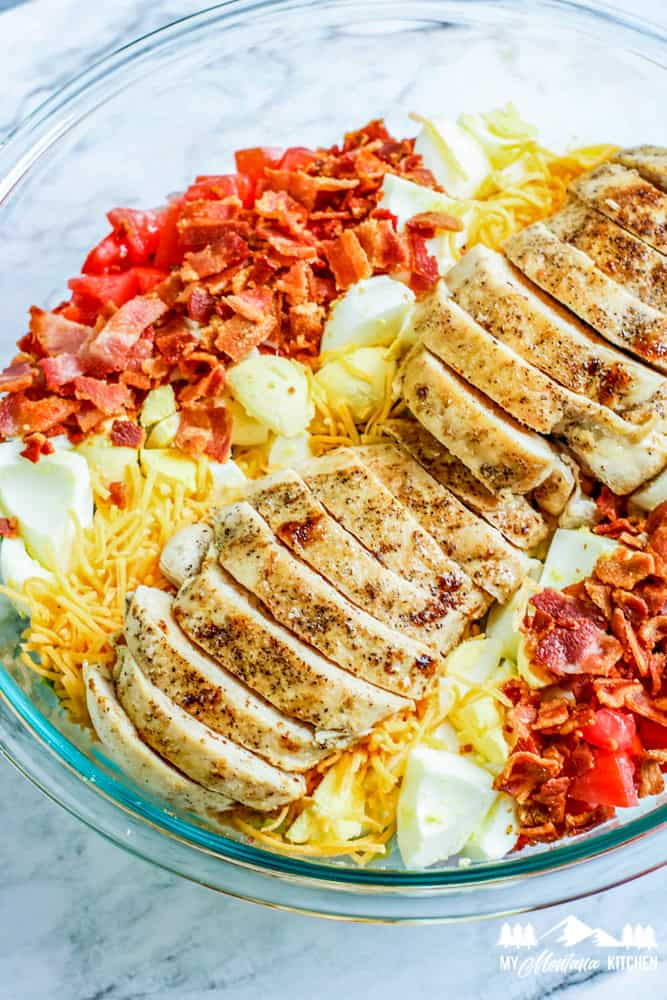 chicken eggs bacon and tomato in bowl