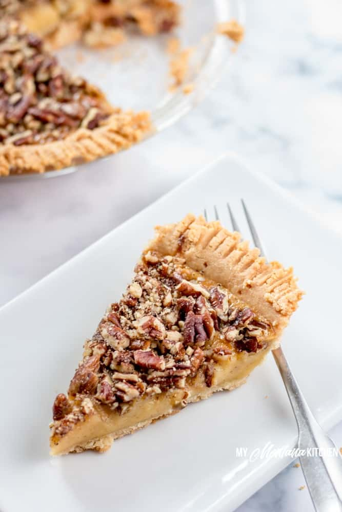 This Sugar Free Pecan Pie uses a low carb condensed milk to replace the traditional corn syrup used in pecan pie. This Low Carb Pecan Pie also works great as a Trim Healthy Mama S Dessert Recipe. #lowcarb #sugarfree #pecanpie #lowcarbpecanpie #sugarfreepecanpie #trimhealthymama #thmpecanpie #thms #glutenfreepecanpie