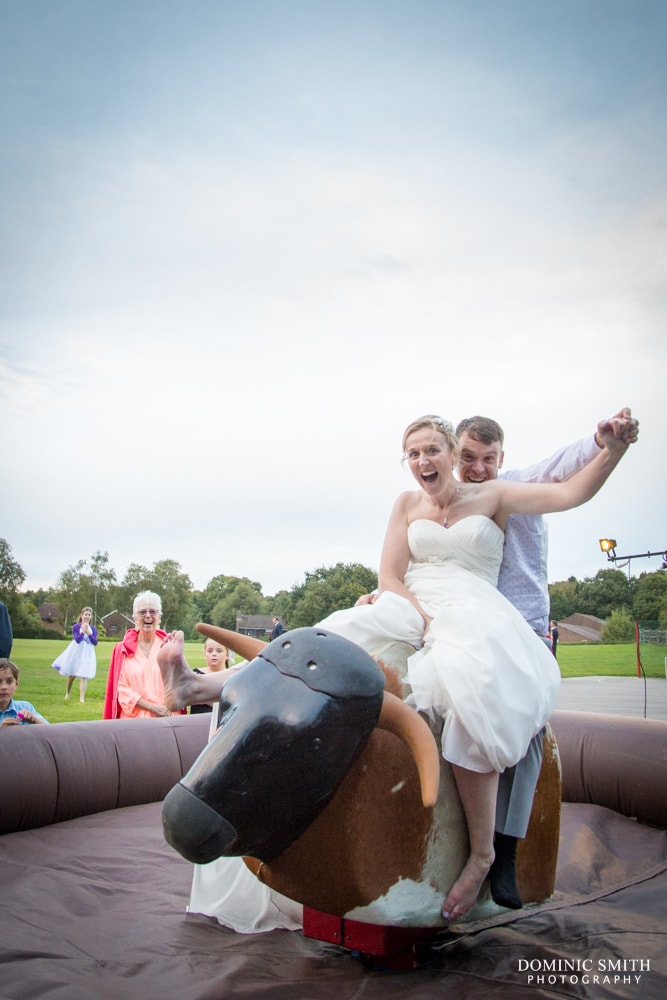 Bride and Groom ride the Bucking Bronco