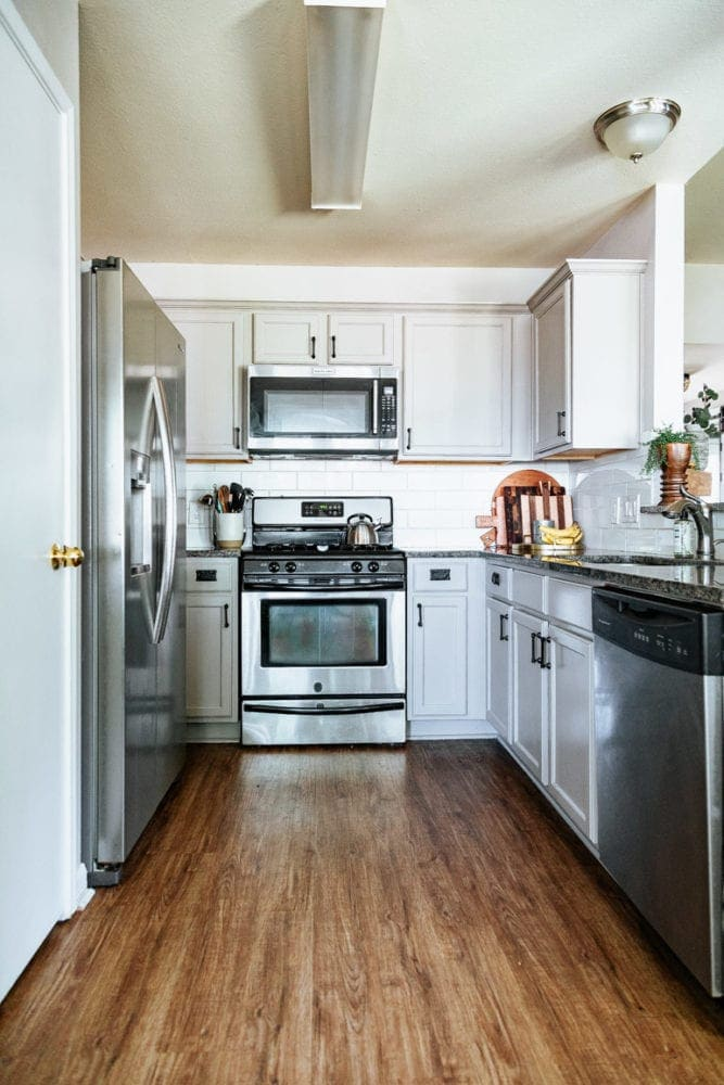 a kitchen with greige kitchen cabinets