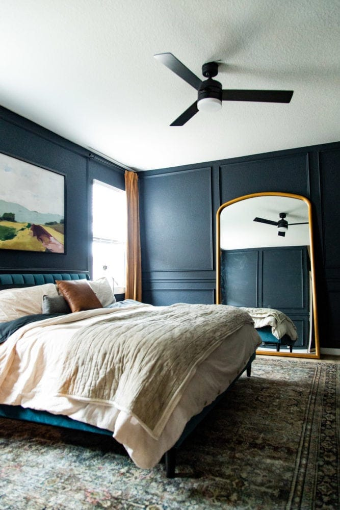 bedroom with picture trim and a large mirror