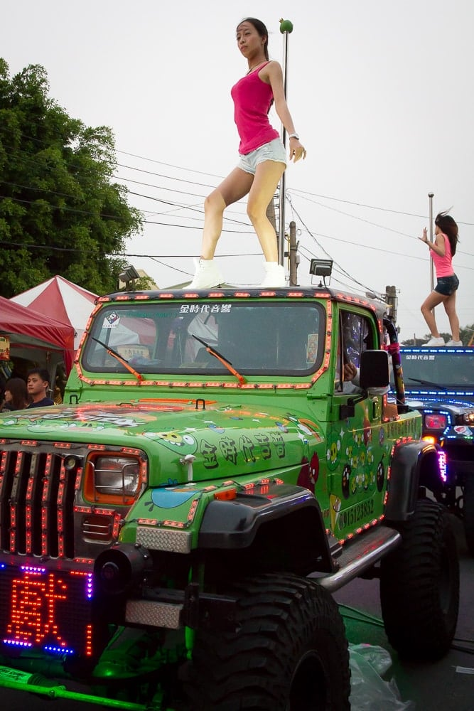 Girls dancing on Jeep in parade