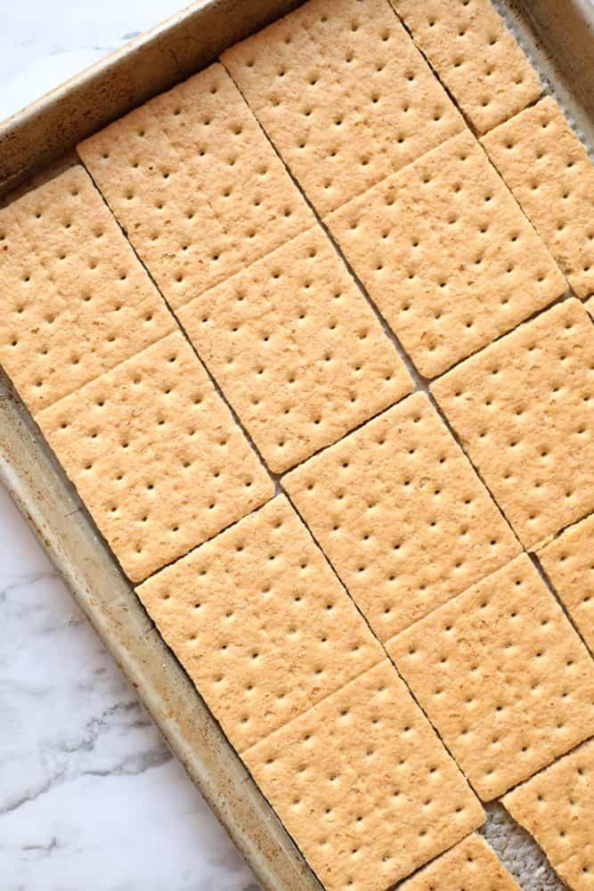 graham crackers lining a baking sheet