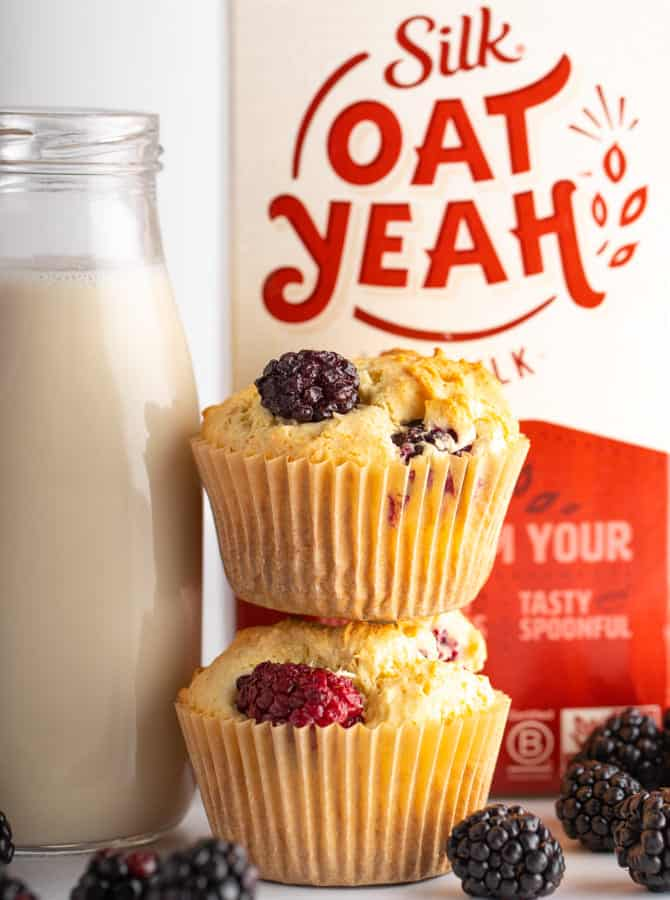 oatYeah oatmilk with two blackberry vegan muffins and glass of oatmilk