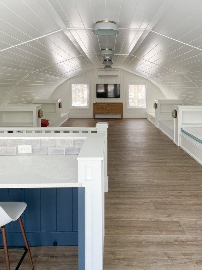 white planked walls and luxury vinyl plank flooring bunk house
