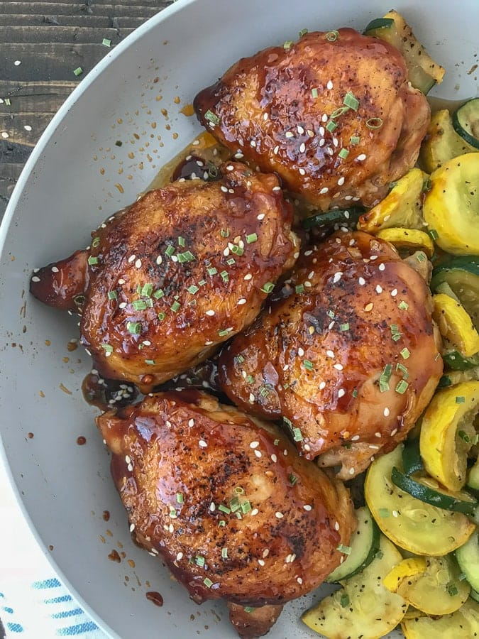 This One-Pan Honey Garlic Chicken Thighs and Squash recipe is the bee's knees! The chicken thighs are cooked in an incredibly delicious honey garlic sauce glaze and is easy to make. Bonus: this entire recipe is cooked using onlyone pan, making cleanup a breeze! #chickenthighs #honeygarlic #onepan #dinner #chicken   https://withpeanutbutterontop.com