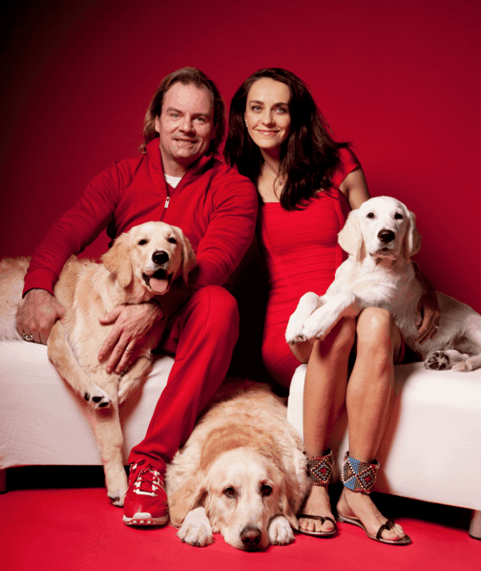 Antonina Lerch, her husband Michael and their 3 golden retrievers.