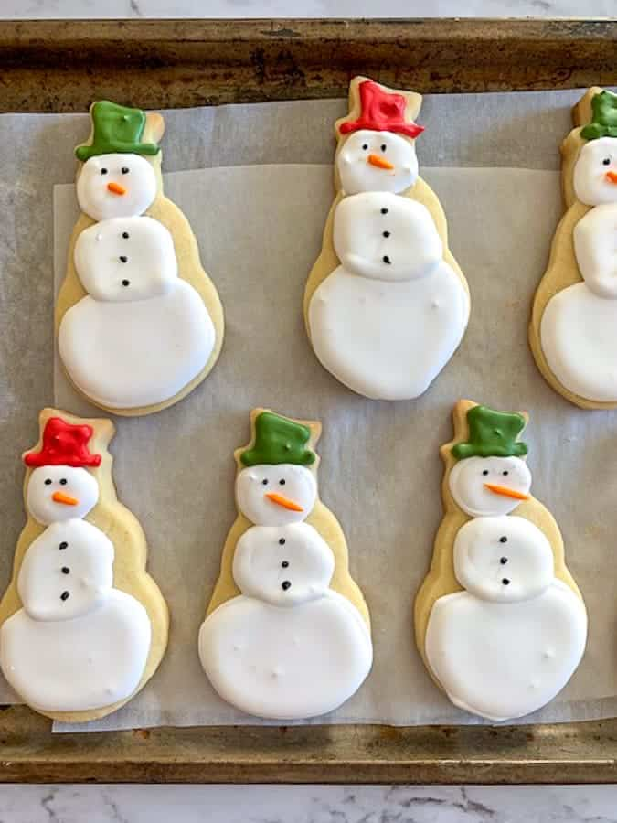 Adorable snowman cookies with royal icing decorations