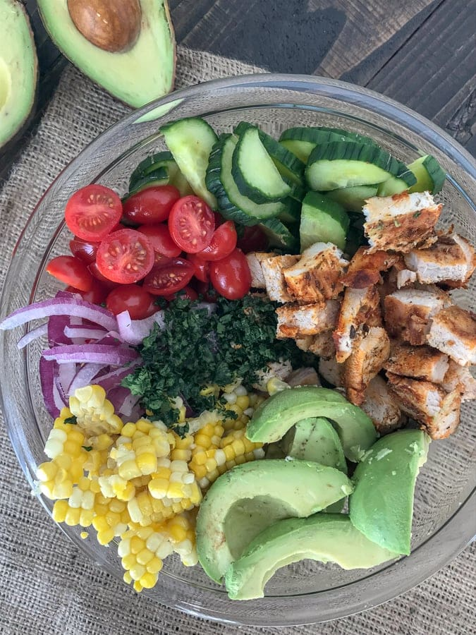 Cajun LimeChicken Avocado Corn Salad - this salad has so much flavor! Creamy, light, and drizzled with a Cilantro Lime Dressing. It is quick and easy to make and perfect for your next barbecue or get together. Light on the calories, coming in at only 203 calories per 1 cup serving. The best part? It's just as delicious the next day, making this a good meal for your to-go lunches. #avocado #salad #chickensalad #healthy | https://withpeanutbutterontop.com