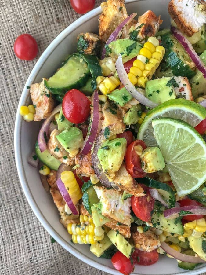 Cajun Lime Chicken Avocado Salad  - this salad has so much flavor! It is quick and easy to make and perfect for your next barbecue or get together. Refreshing, creamy, and filling - but light! Light on the calories, coming in at only 203 calories per 1 cup serving. The best part? It's just as delicious the next day, making this a good meal for your to-go lunches for either work, school or travel. #lunch #togo #avocado #avocadosalad #salad #chickensalad #healthy | https://withpeanutbutterontop.com