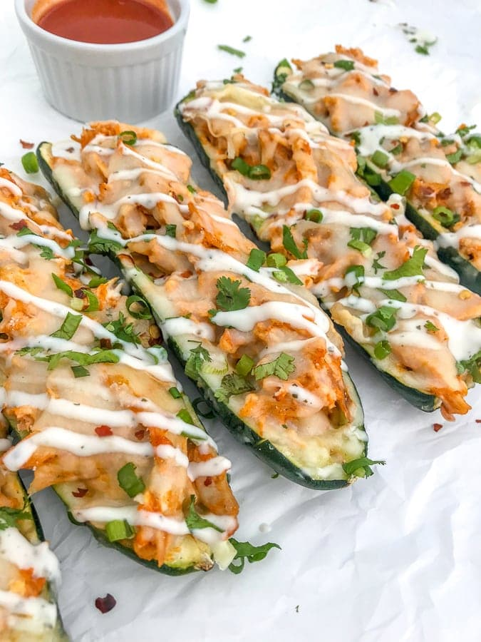 Buffalo Chicken Stuffed Zucchini Boats - a super simple and delicious 5-ingredient recipe that your family will love! #zucchini #buffalochicken #recipes |https://withpeanutbutterontop.com