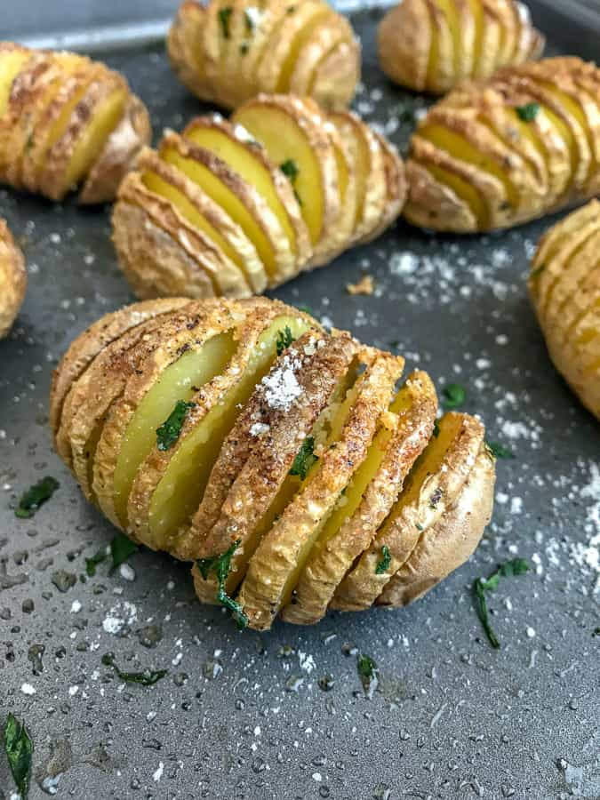 Mini Garlic Butter Parmesan Hasselback Potatoes - super easy side dish to make that is perfect for any occasion! Crispy on the outside, flaky on the inside, and incredibly delicious! #hasselback #potatoes #sidedish | https://withpeanutbutterontop.com