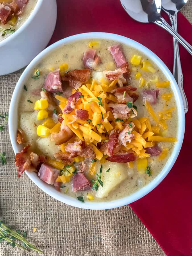 Instant Pot Ham Potato and Corn Chowder - an easy-to-make, one pot soup that uses leftover ham bone and ham from the holidays! Full of sweet corn, potatoes, and salty chunks of ham. Sure to be a crowd pleaser at your dinner table! #soup #hambone #ham #chowder #onepot | https://withpeanutbutterontop.com