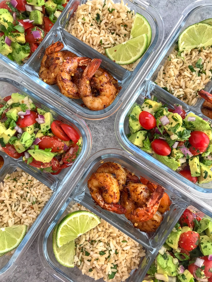 Step up your meal prep game with this super simple, healthy, and delicious Blackened Shrimp Meal Prep! Full of bold flavors and easy to put together. These are packed with blackened shrimp, cilantro lime brown rice, and an incredible avocado salsa. #mealprep #blackenedshrimp #blackenedshrimpmealprep #shrimp #healthy | https://withpeanutbutterontop.com