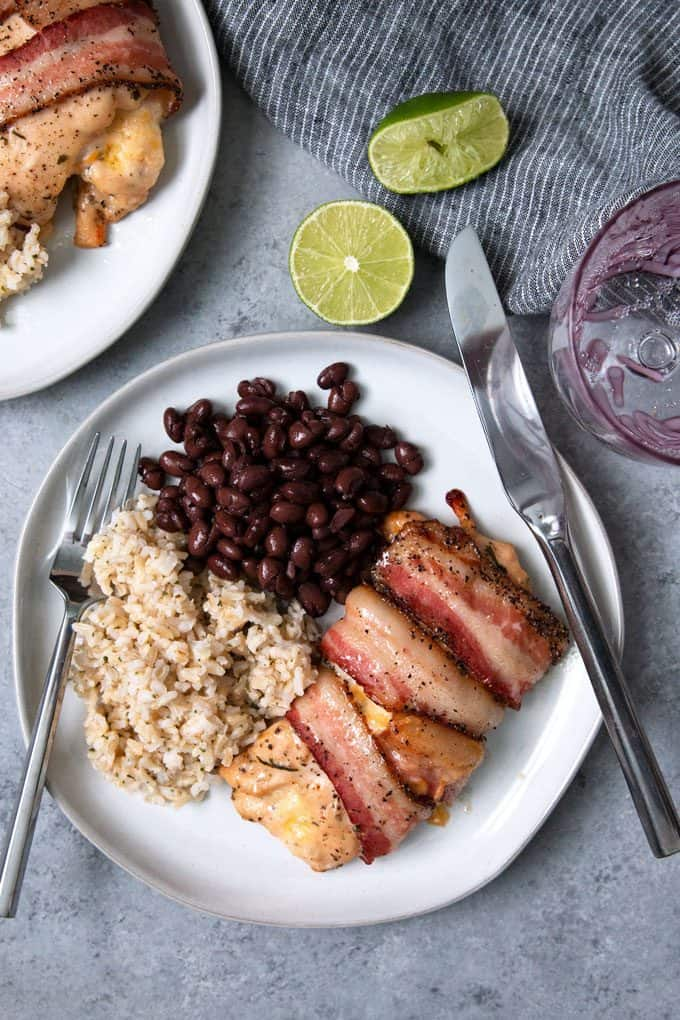 picture of cilantro lime chicken wrapped in bacon with beans and rice
