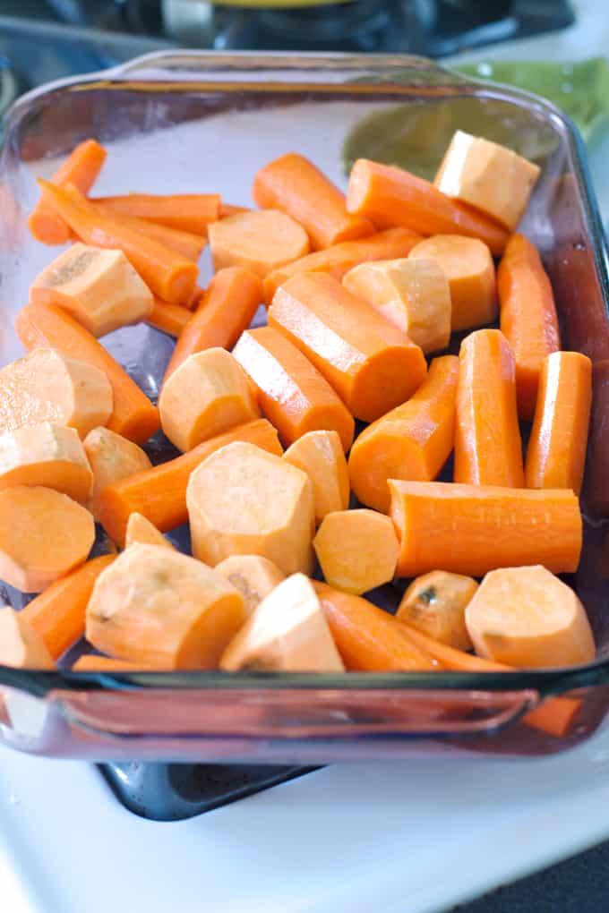 Carrots and sweet potato chucks in a baking dish.
