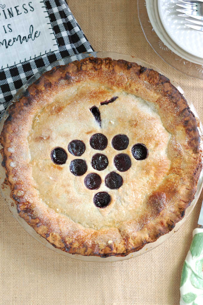 a freshly baked concord grape pie, top view